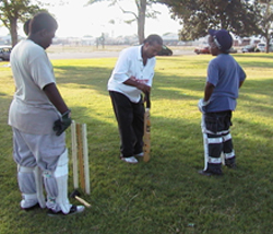 Theo Hayes showing cricket to youth